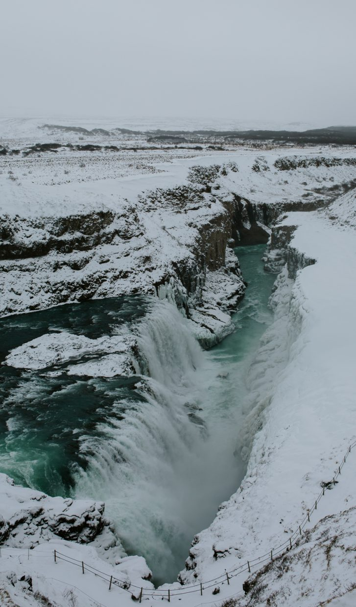 Wild Gulfoss waterfall with snow in Iceland